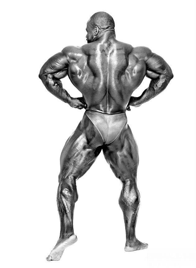 Chris Cormier showing his back, large quads and bulging delts