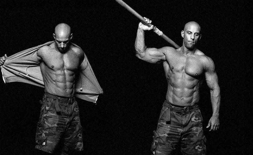 Christian Thibaudeau in double shot, showing his ripped abs, large arms and chest