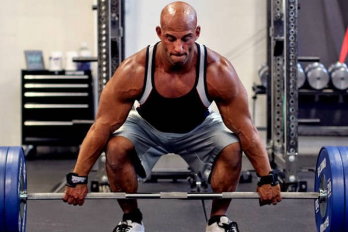 Christian Thibaudeau completing a deadlift, showing his large arms and legs