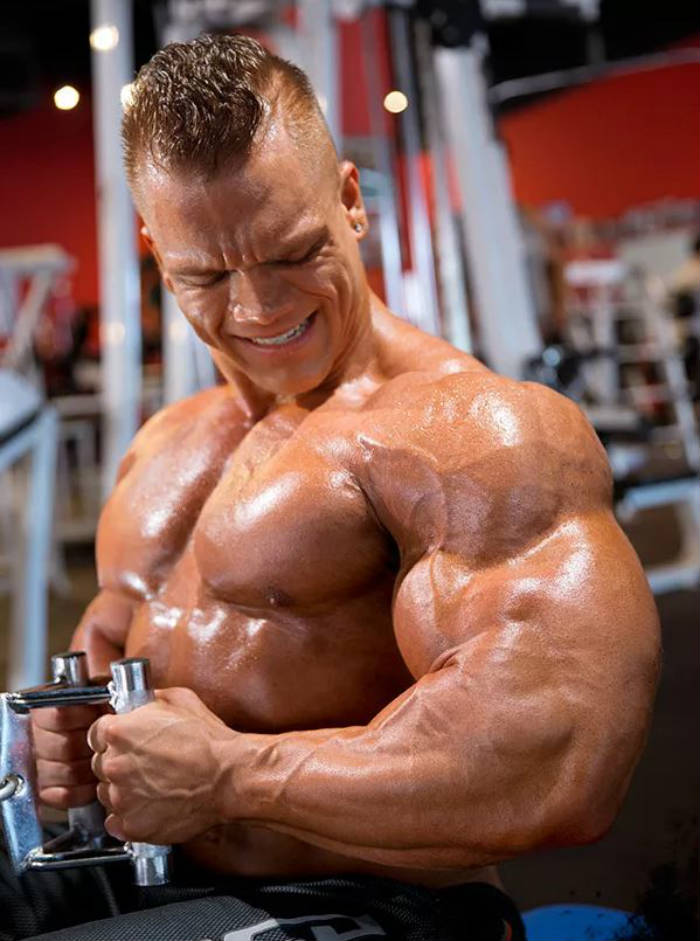 Dallas Mccarver completed a lateral row, showing his large arms, pumped chest and large abs