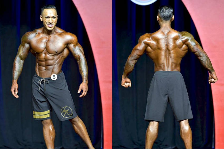Dean Balabis showing his back and front profile, displaying his large delts, lats, chest and abs