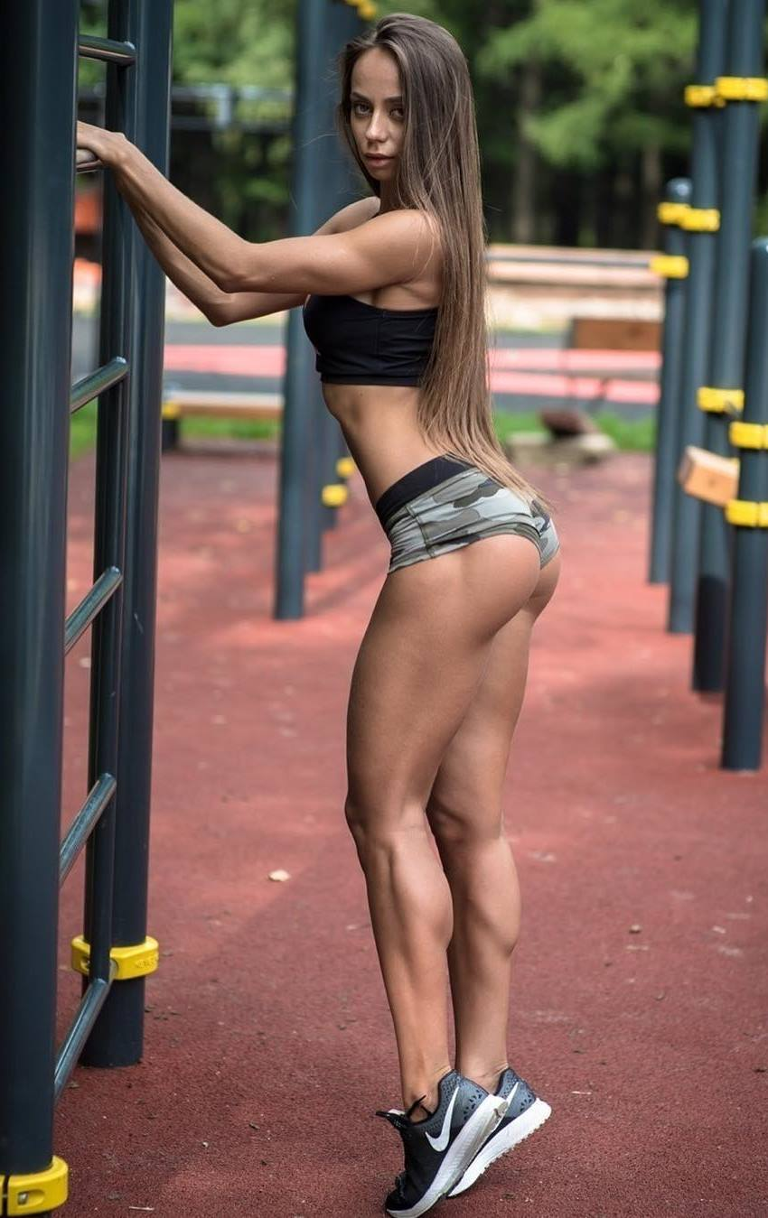 Ekaterina Shokhina on a playground, showing her incredible calves, legs, and glutes from the side