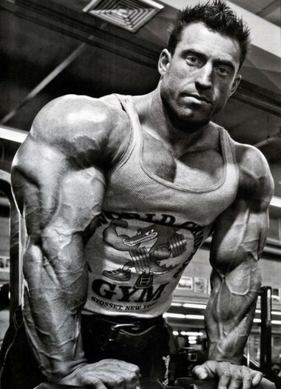 Erik Fankhouser showing his large arms and large traps