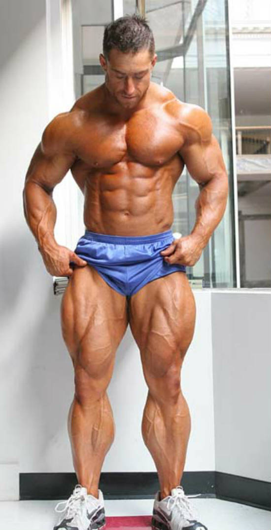 Erik Fankhouser showing his full body, including his large quadriceps and ripped abs
