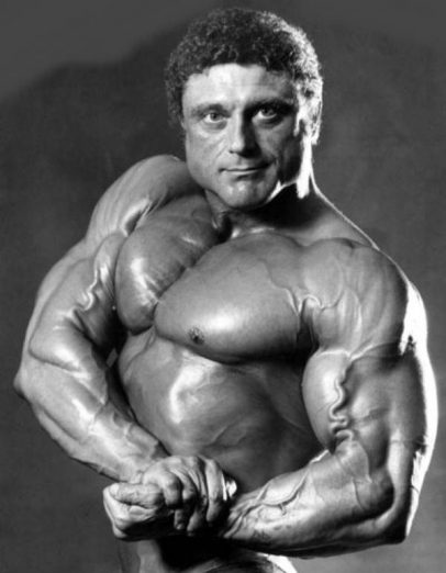 Frank Richards flexing his biceps and showing off his upper body for the camera