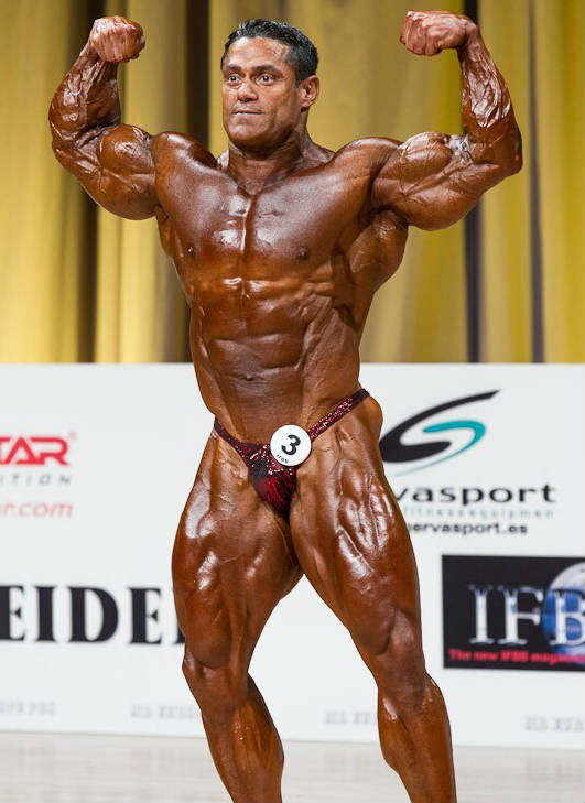 Gustavo Badell showing off his toned physique, displaying his ripped and and quads