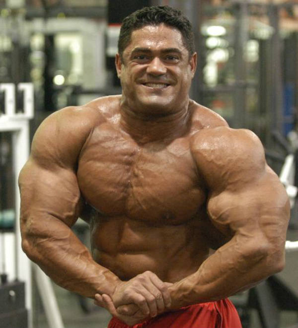 Gustavo Badell tensing his large bicep and showing his vascular chest and arms