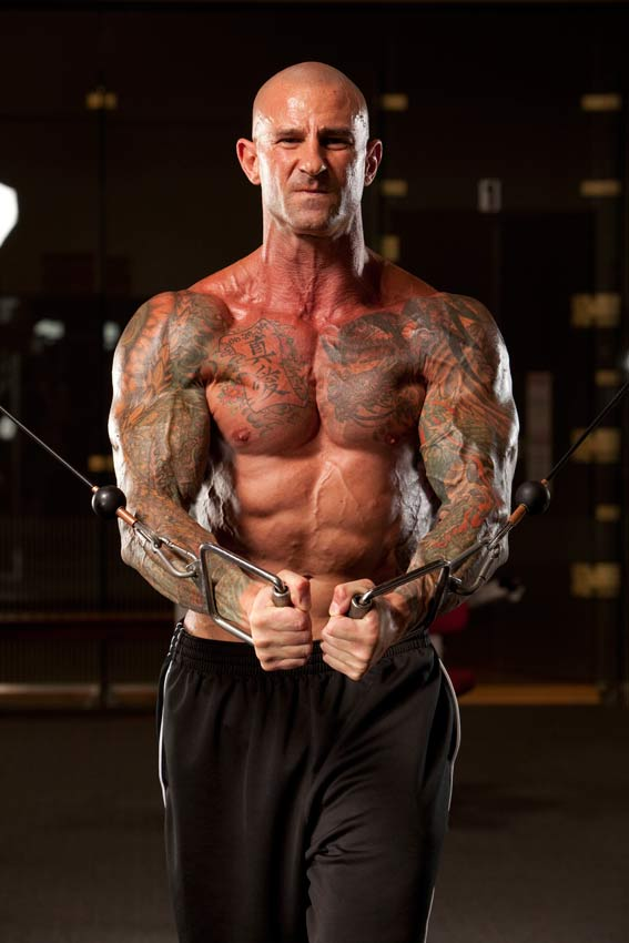 Jim Stoppani shirtless, doing cable crossovers