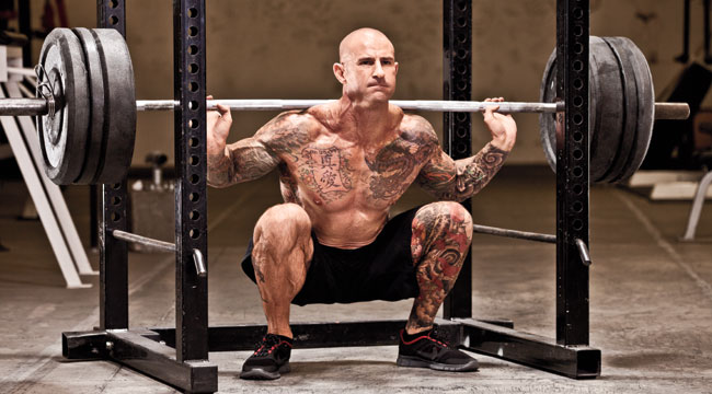Shirtless Jim Stoppani doing deep heavy squats