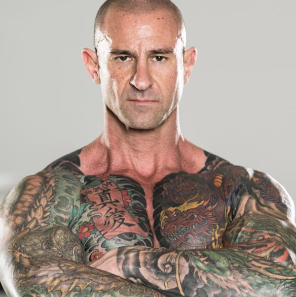 Jim Stoppani with his arms crossed, looking directly into the camera