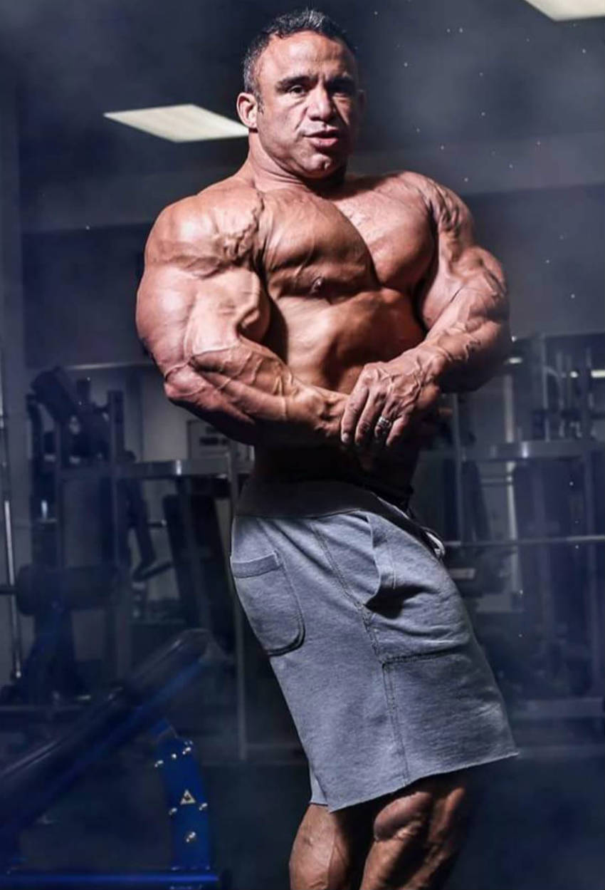 Jose Raymond tensing his arm and showing his bulging vascular bicep and delt