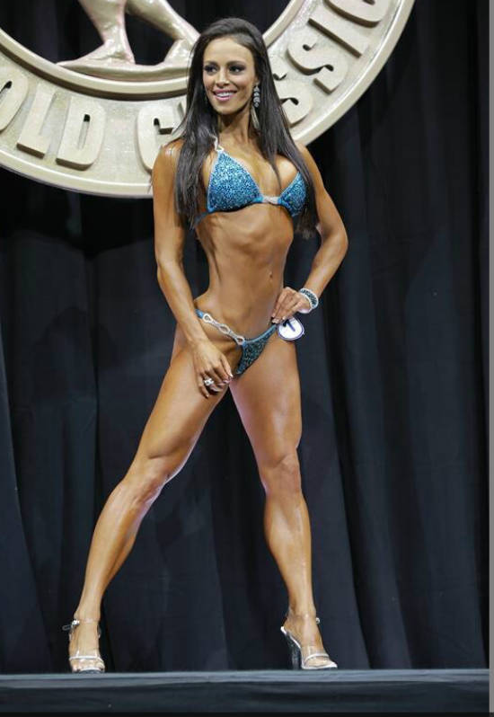Juliana Daniell showing her toned abs and quads at a competition
