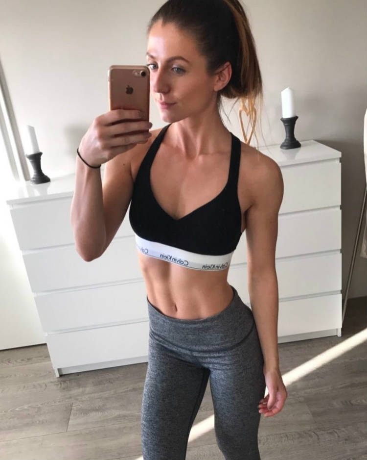 Kristin Gudlaugsdottir showing her toned abs and arms