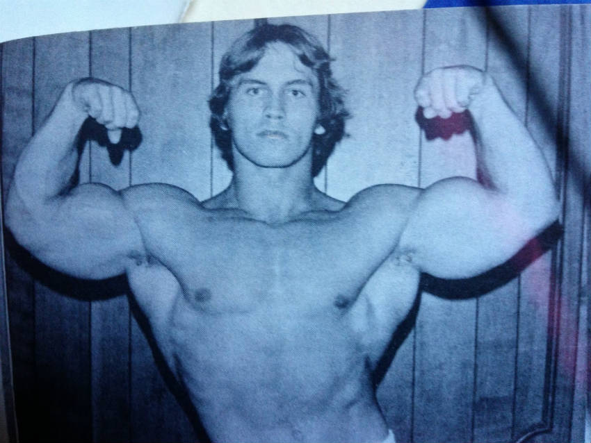 Lance Dreher flexing his arms in the 1970's, showing his large biceps