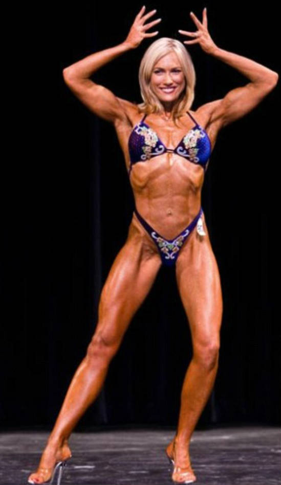 Lindy Olsen posing with he hands above her head at an Australian competition