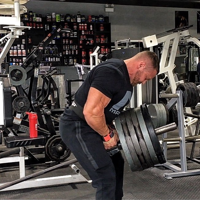 Marc Lobliner doing heavy t-bar rows in the gym