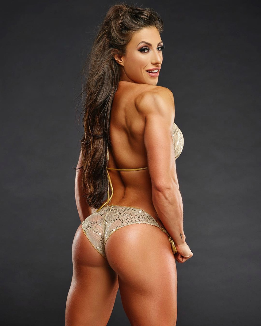 Margherita Di Bari in a bikini, posing for a photoshoot, as she shows her awesome glutes, back, and shoulders