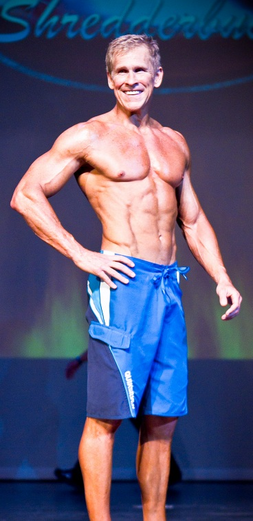 Mark Mcilyar showing his ripped abs and toned arms at a competition