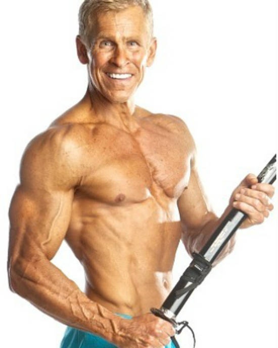 Mark Mcilyar holding a katana, showing his ripped abs, large chest and pumped delts