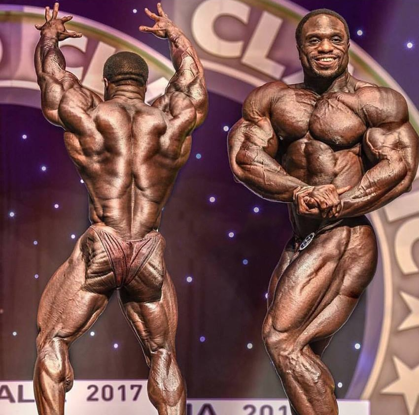 Michael Lockett in two different poses on the stage, one side chest, and the other back pose, having incredible conditioning