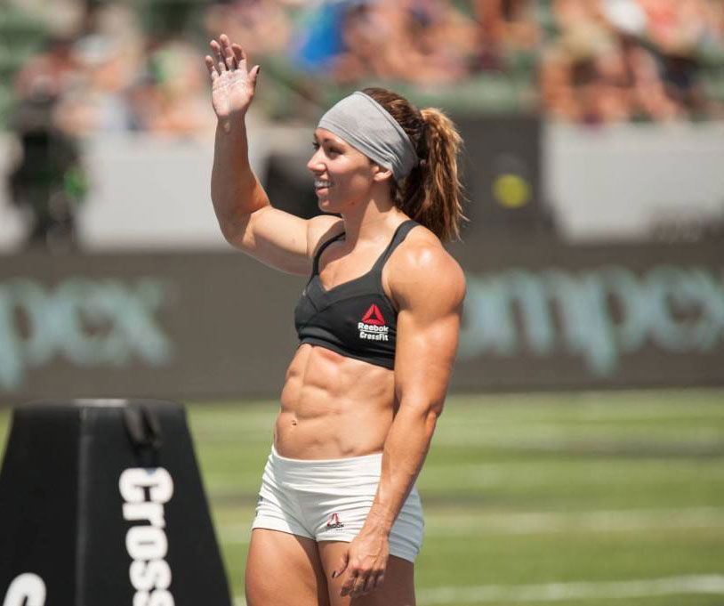 Miranda Oldroyd waving to the crowd in a Crossfit competition