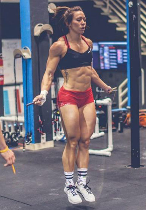Miranda Oldroyd skipping inside a gym looking strong and ripped