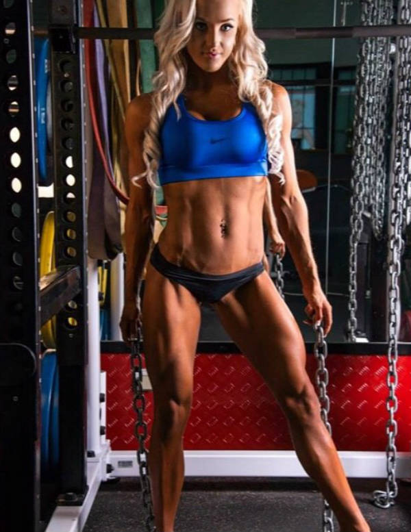 Nina Anderson showing her ripepd abs, toned arms and toned quads