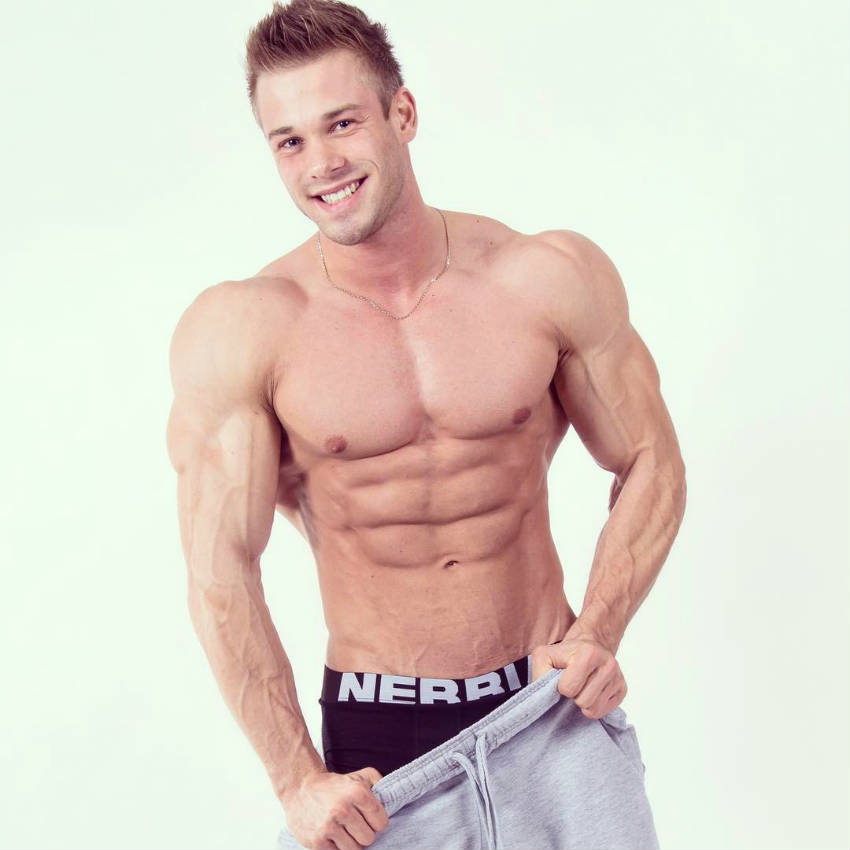 Ondrej Kmostak showing his ripped abs. large chest and huge delts