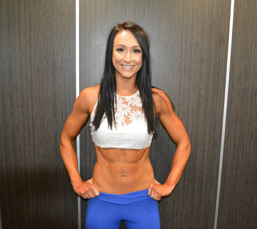 Rachel Morrissey showing her ripped abs and toned arms