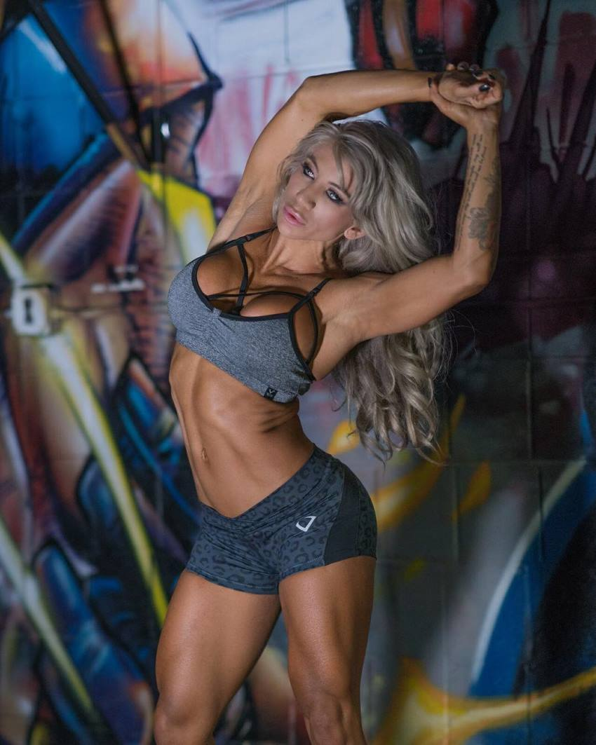 Rachelle Carter stretching her lean muscles, while wearing a sportsbra and sporty short pants