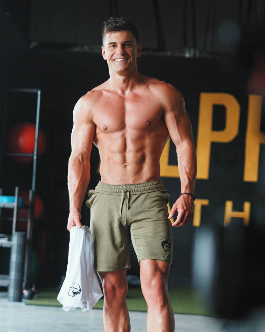 Rob Lipsett showing his full body, including his ripped abs and vascular arms