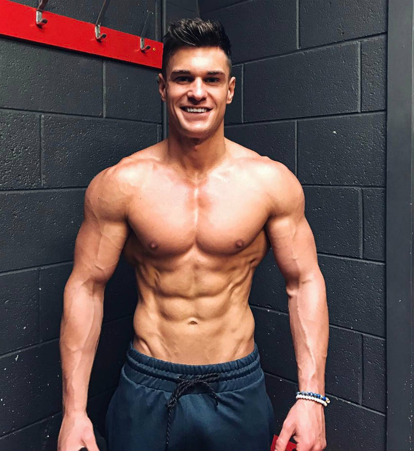 Rob Lipsett showing his ripped abs and vascular arms