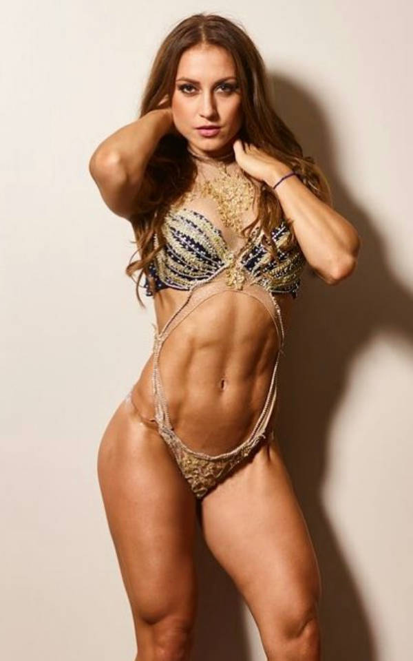 Sandra Radav posing in a bikini and showing off her toned abs
