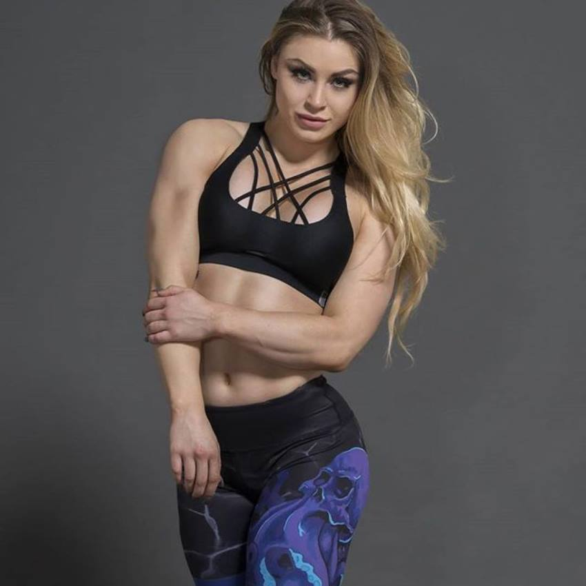 Syleena Adams doing a photo shoot, wearing a sports outfit, looking lean and fit