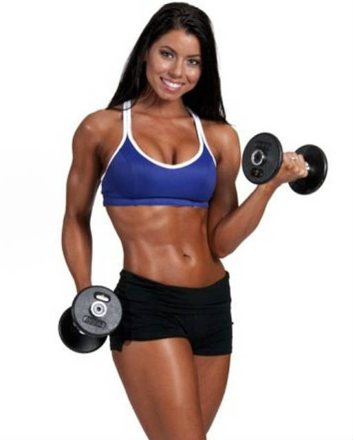 Tara LaValley completing a dumbbell curl with small dumbbells, showing her bicep definition