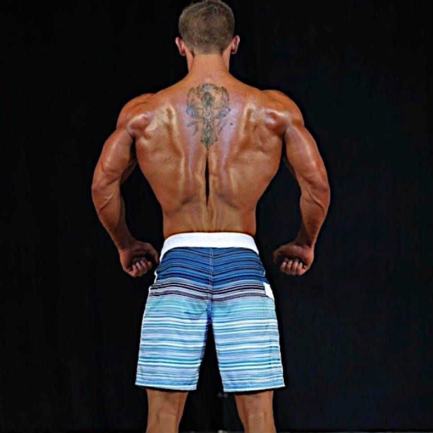 Tyler Stines shows his ripped back and toned triceps at a physique competition
