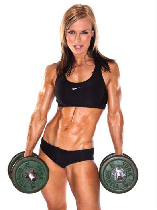 Allison Ethier holding dumbbells, showing off her toned abs and arms