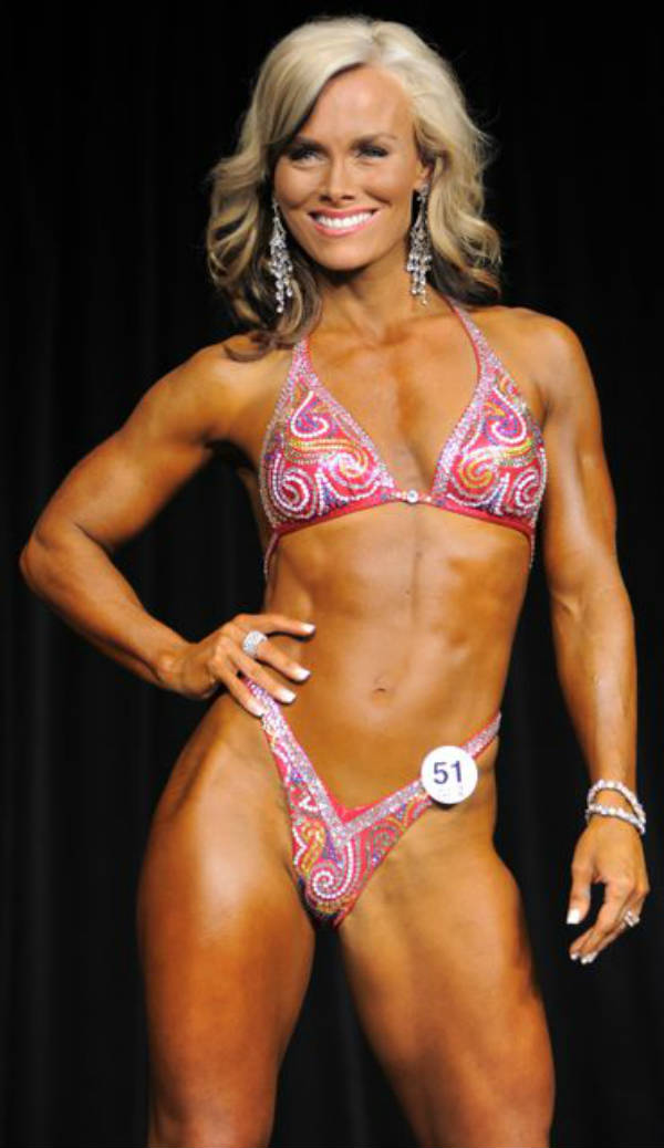 Allison Ethier standing in a bikini, showing her toned abs and quads