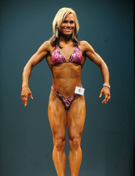 Allison Ethier showing her toned physique at a competition