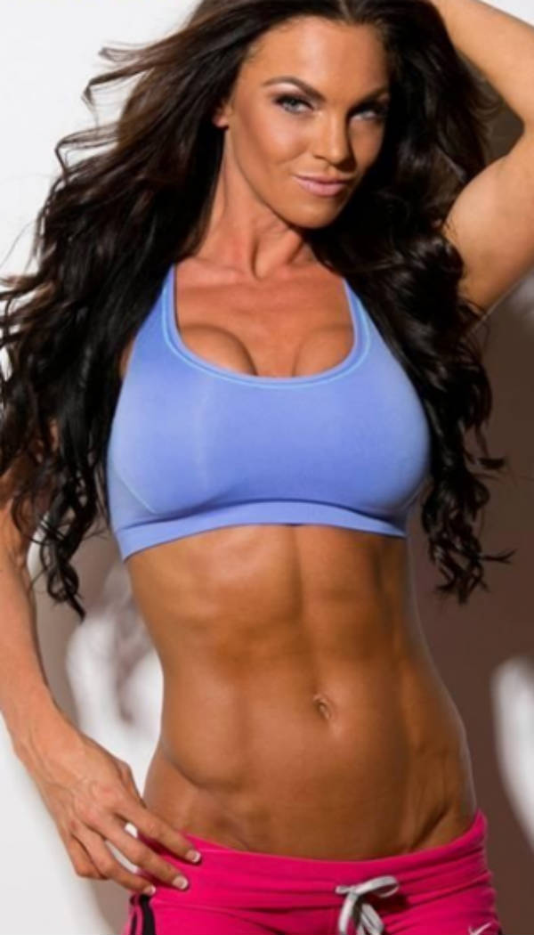 Amber Dawn Orton showing her toned abs and vascular arms