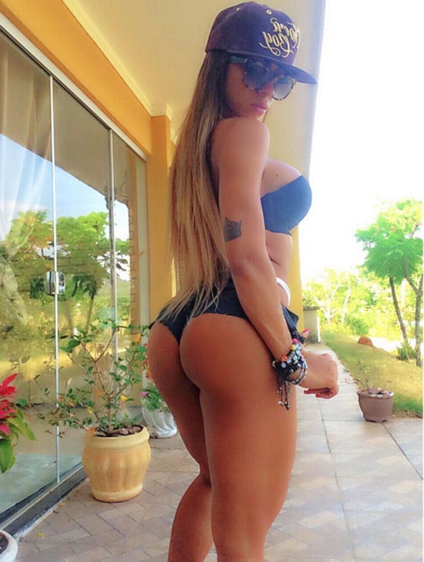 Bianca de Freitas Vitoria showing her awesome glutes and legs while standing in front of a beautiful house and nature