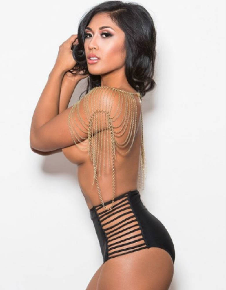 Genevieve Ava showing her toned figure in risque shot