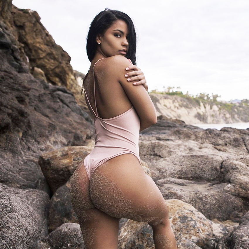 Jade Ramey showing her body and glutes on a beach wearing gym clothes