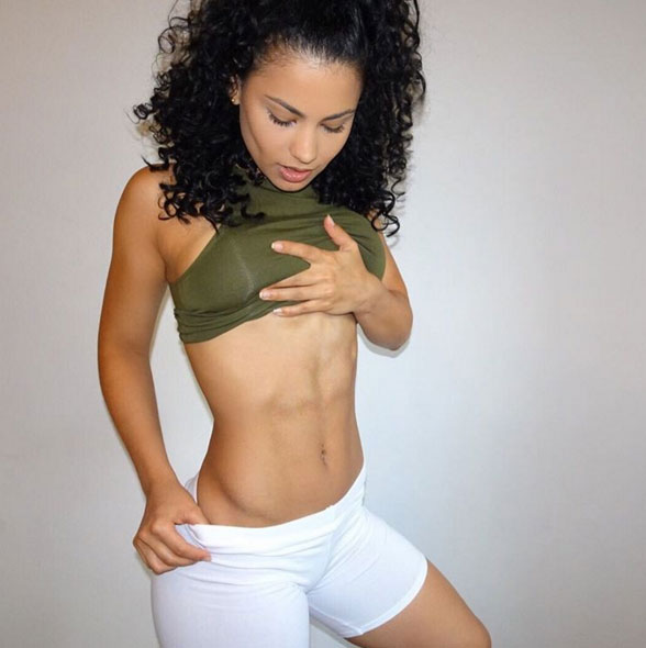 Jade Ramey showing off her abs to the camera