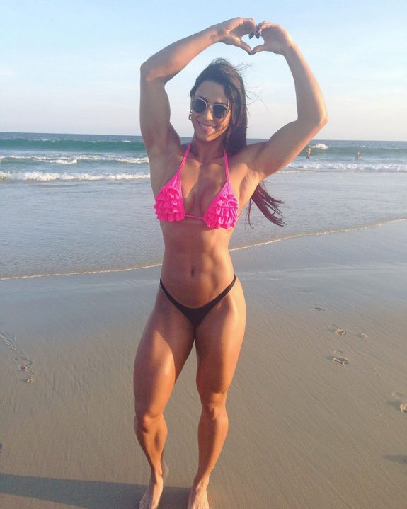 Jessica Felipe standing on a beach looking lean and strong