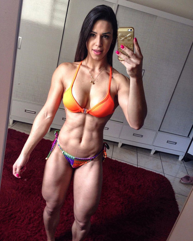 Jessica Felipe posing in the mirror taking a selfi looking ripped with large muscles