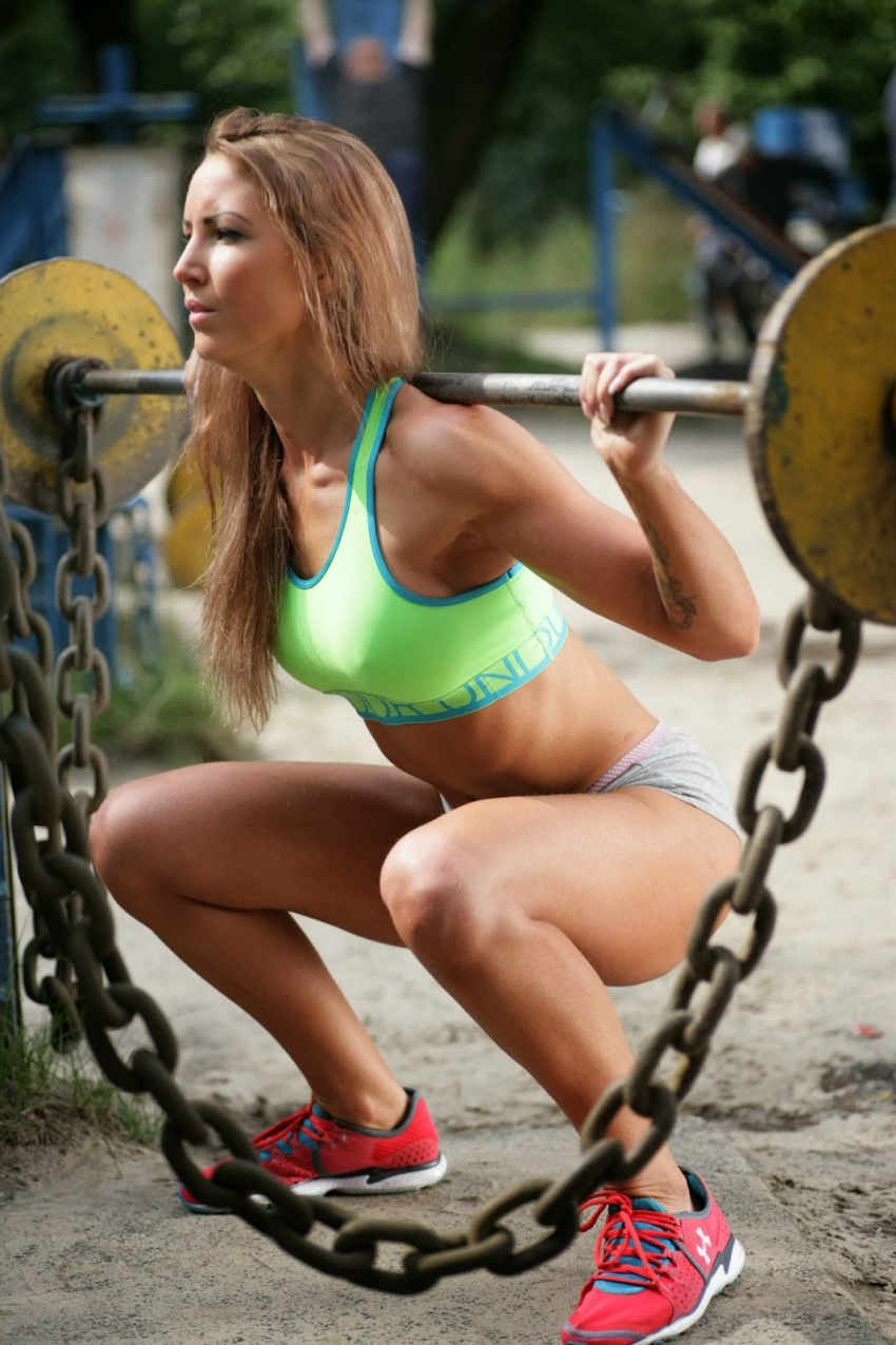 Karen Lind Thompson doing squats in an old-school outdoors gym, looking fit and healthy