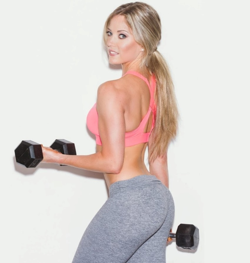Katie Crewe lifting dumbbels, looking fit and aesthetics
