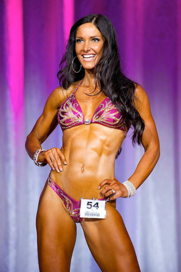 Lori Harder showing her toned abs and legs at a competition