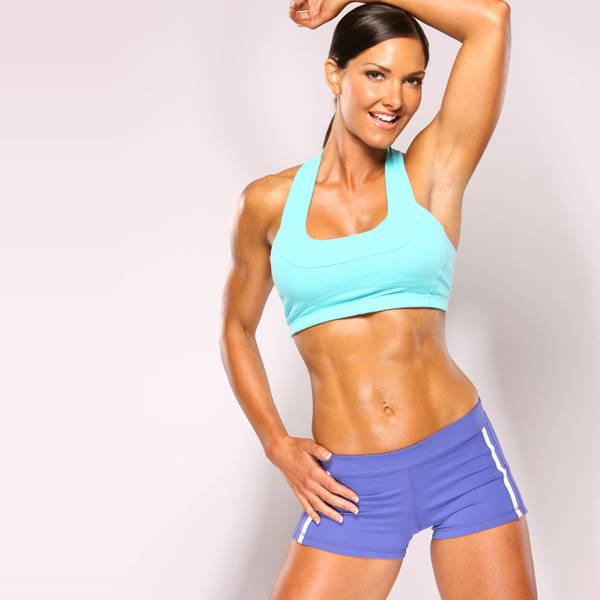 Lori Harder showing her toned abs and lean arms in a photoshoot shot